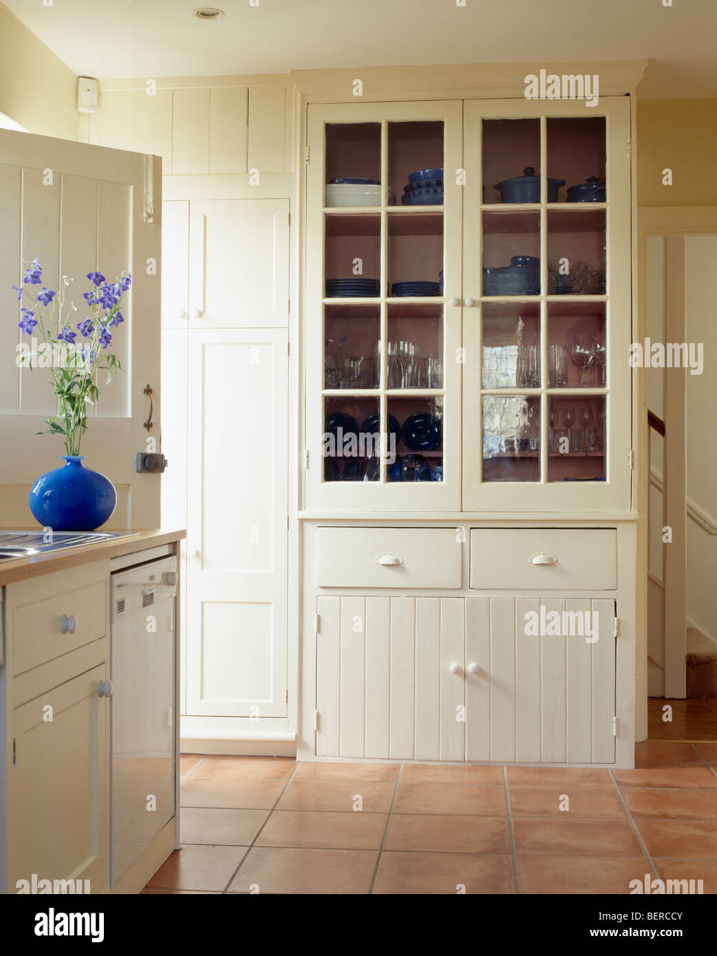 Fitted Cream Dresser In Cream Country Kitchen With Terracotta Tiled Floor