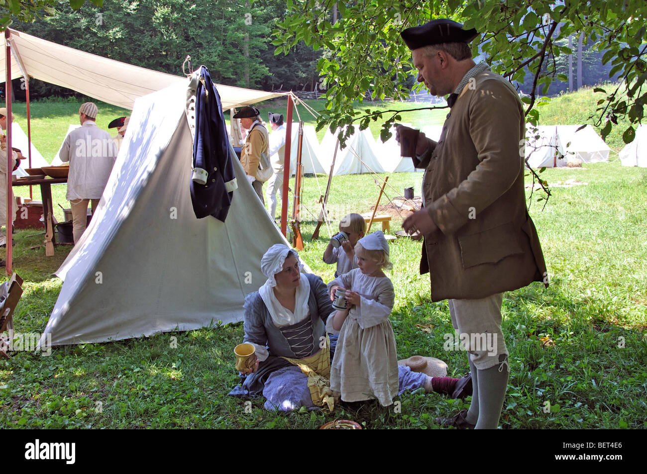 Family in army tent c& - costumed American Revolutionary War (1770u0027s) era re-enactment & Family in army tent camp - costumed American Revolutionary War ...