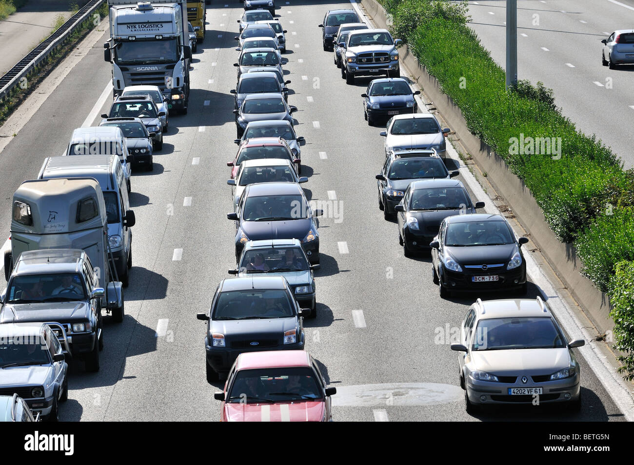 Cars queueing in highway lanes during traffic jam on motorway ...