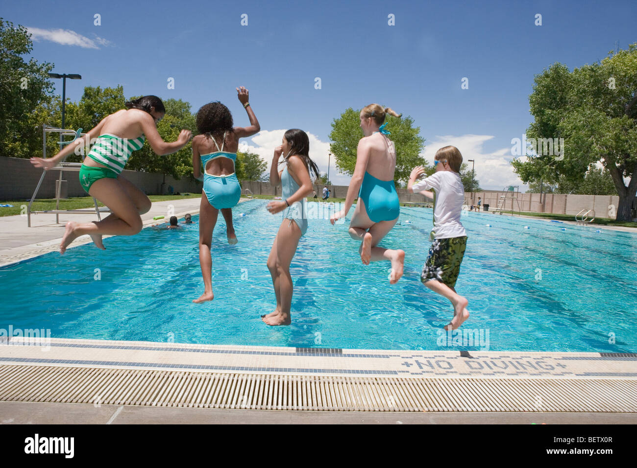 Kids Public Swimming Pool Five Jumping Into A L