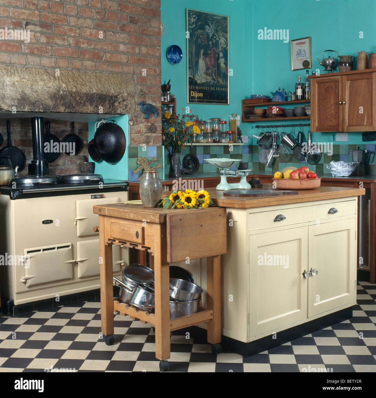 Black Country Kitchen butcher's block beside cream island unit in turquoise country