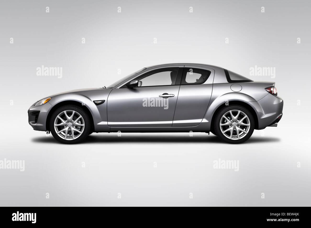2010 mazda rx-8 sport in silver - drivers side profile stock photo