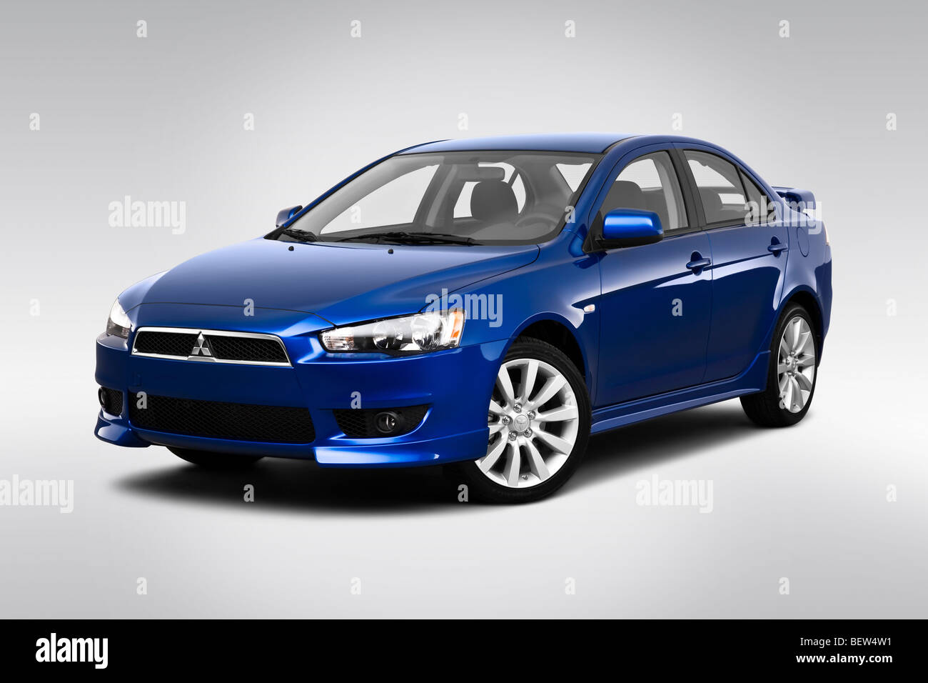 2010 mitsubishi lancer gts in blue front angle view stock photo royalty free image 26368189. Black Bedroom Furniture Sets. Home Design Ideas