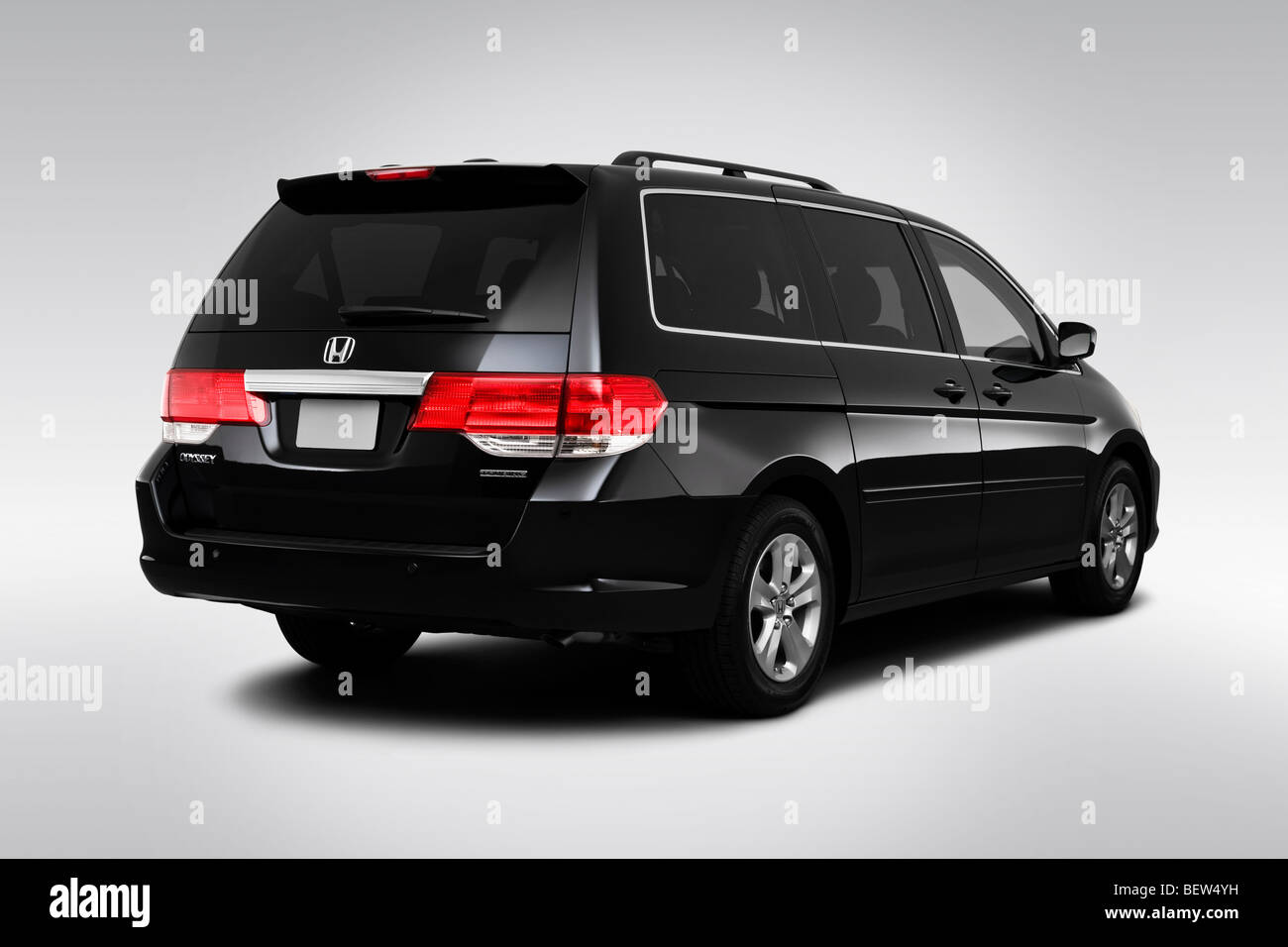 2010 Honda Odyssey Touring in Black  Rear angle view Stock Photo