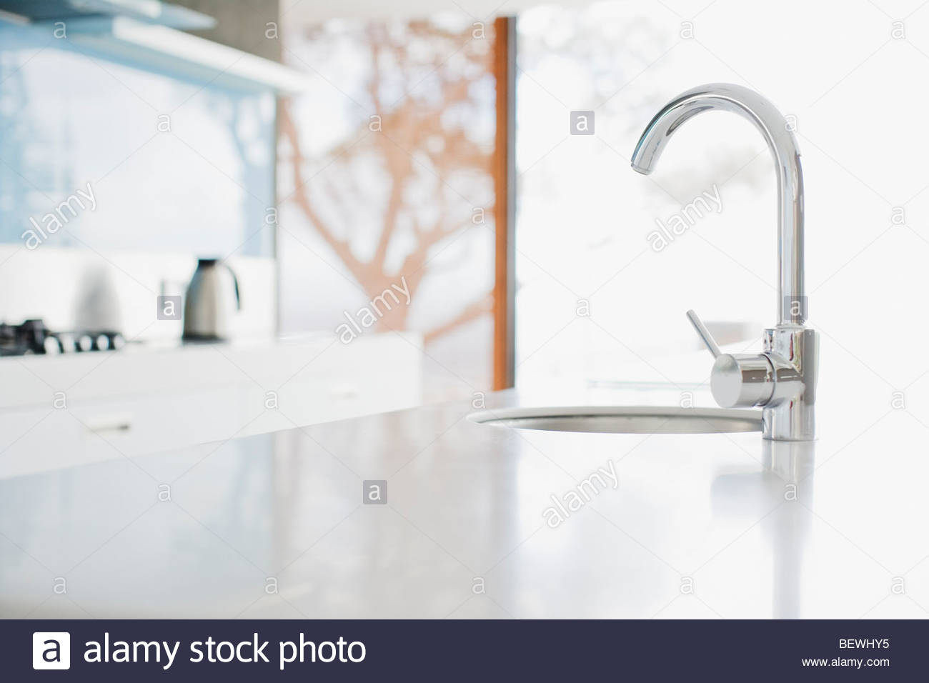 Close up of modern kitchen faucet and sink Stock Photo, Royalty ...