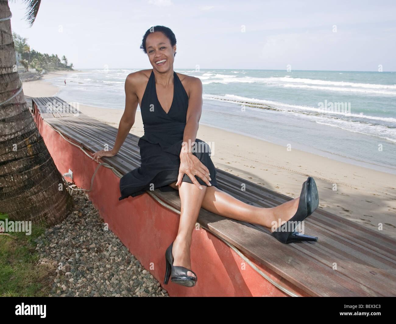 women ocean backdrop crossed legs stock photo royalty