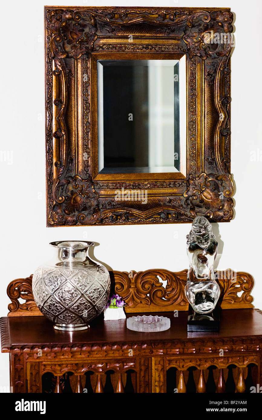 Showpieces On A Chest With Mirror In A Living Room Part 32