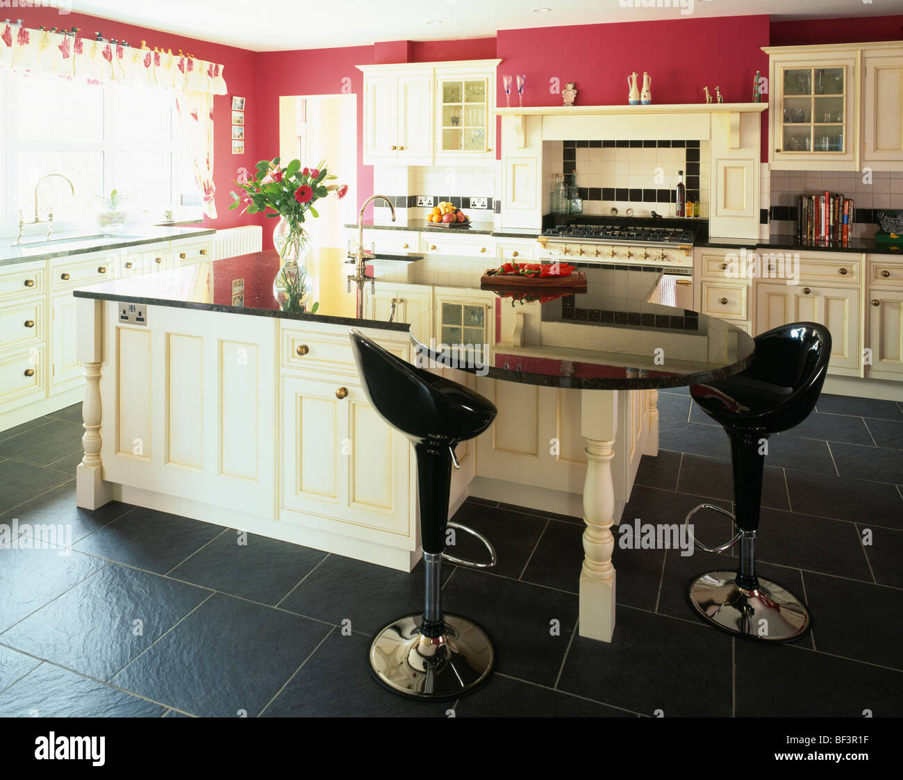 Red Floor Tiles Kitchen Black Bombo Stools At Curved Breakfast Bar In Red Kitchen With