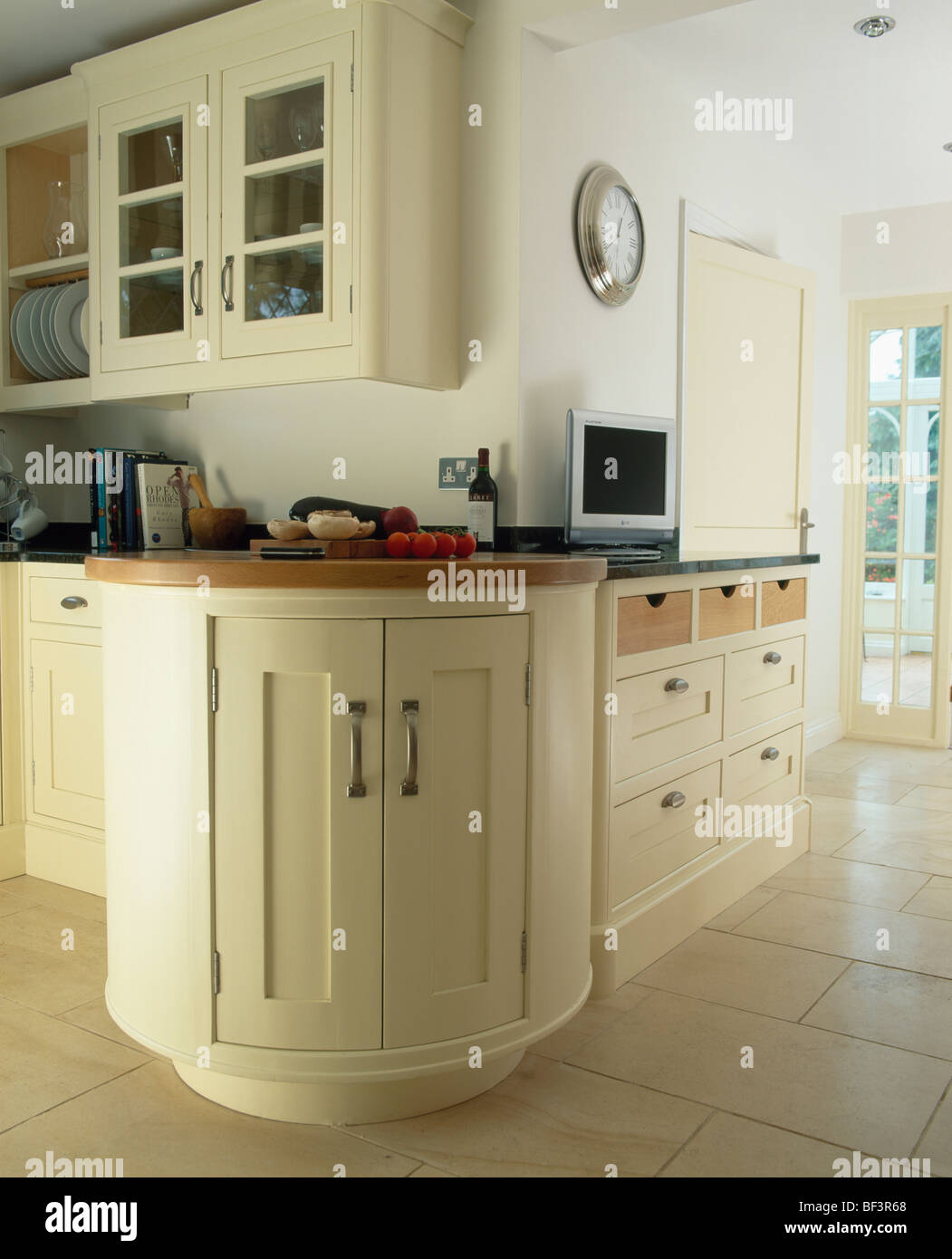 Curved Fitted Unit In Large Traditional Cream Country Kitchen Painted In Farrow Ball Paint