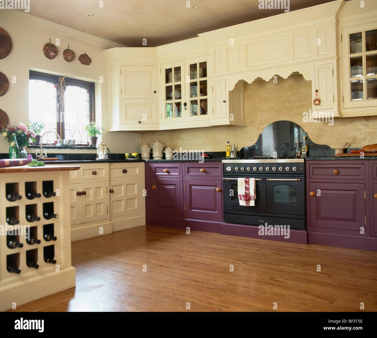 Vinyl wood effect flooring and cream cupboards in kitchen for Wood effect kitchen cupboards