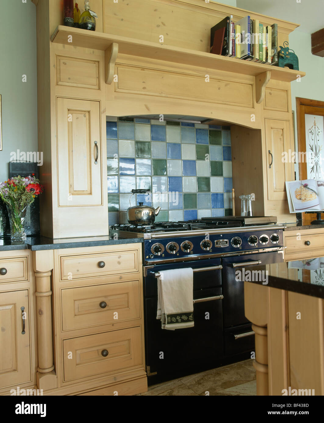 Green country kitchen -  Blue Green And Cream Ceramic Tiles Above Black Range Oven In Traditional Country Kitchen
