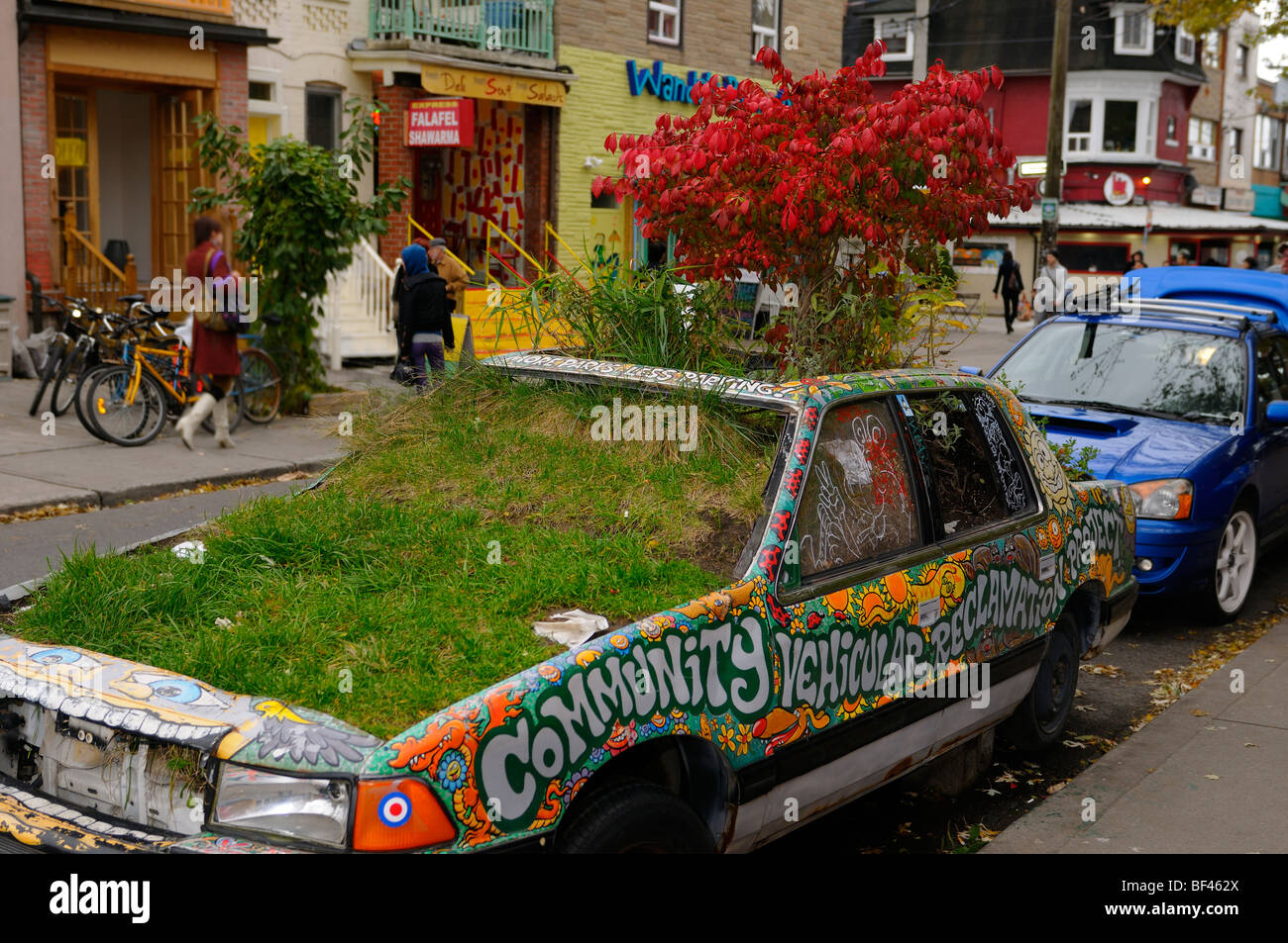 Wacky junked car parked on Toronto street filled with earth and ...