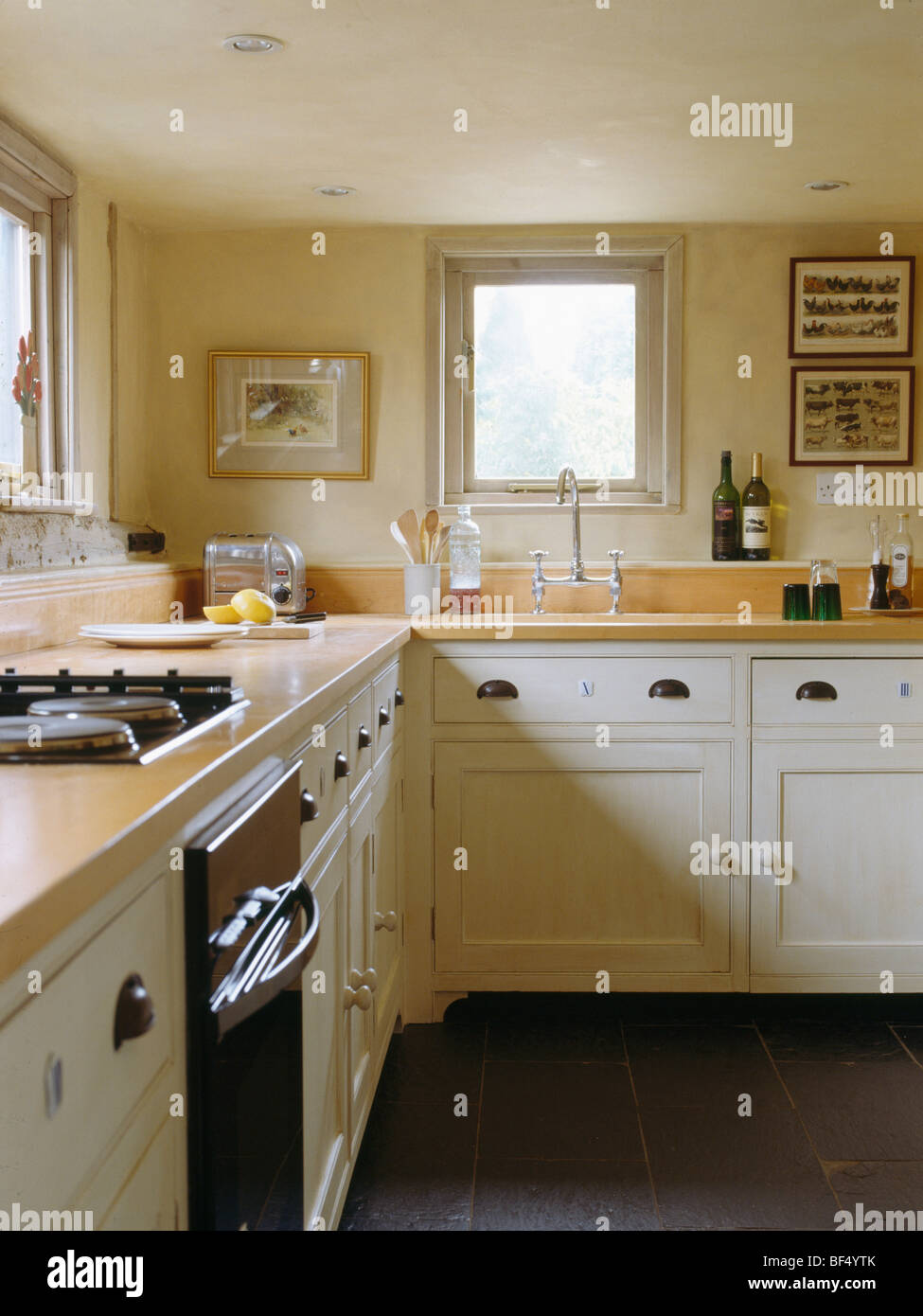 Cream fitted units with wood worktops in cream cottage for Wooden fitted kitchen