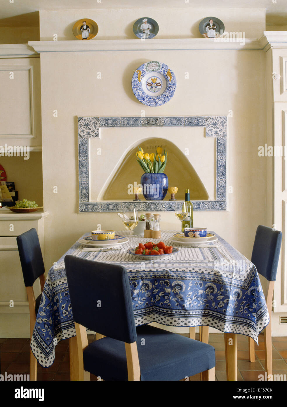 blue patterned tablecloth on table with dark blue upholstered