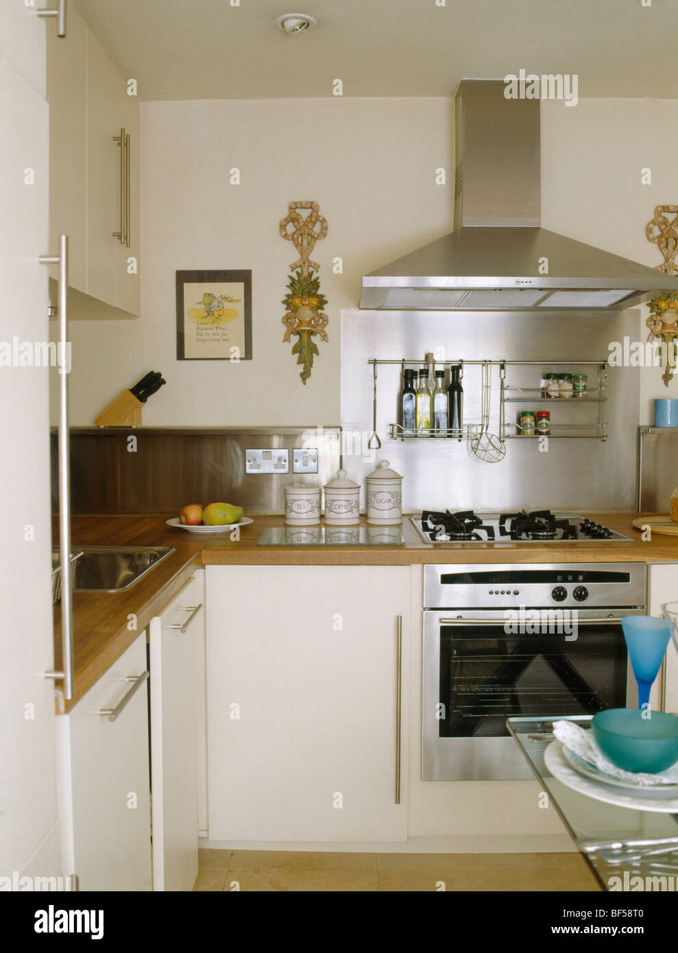 Small modern cream kitchen with stainless steel extractor for Small kitchen ideas uk