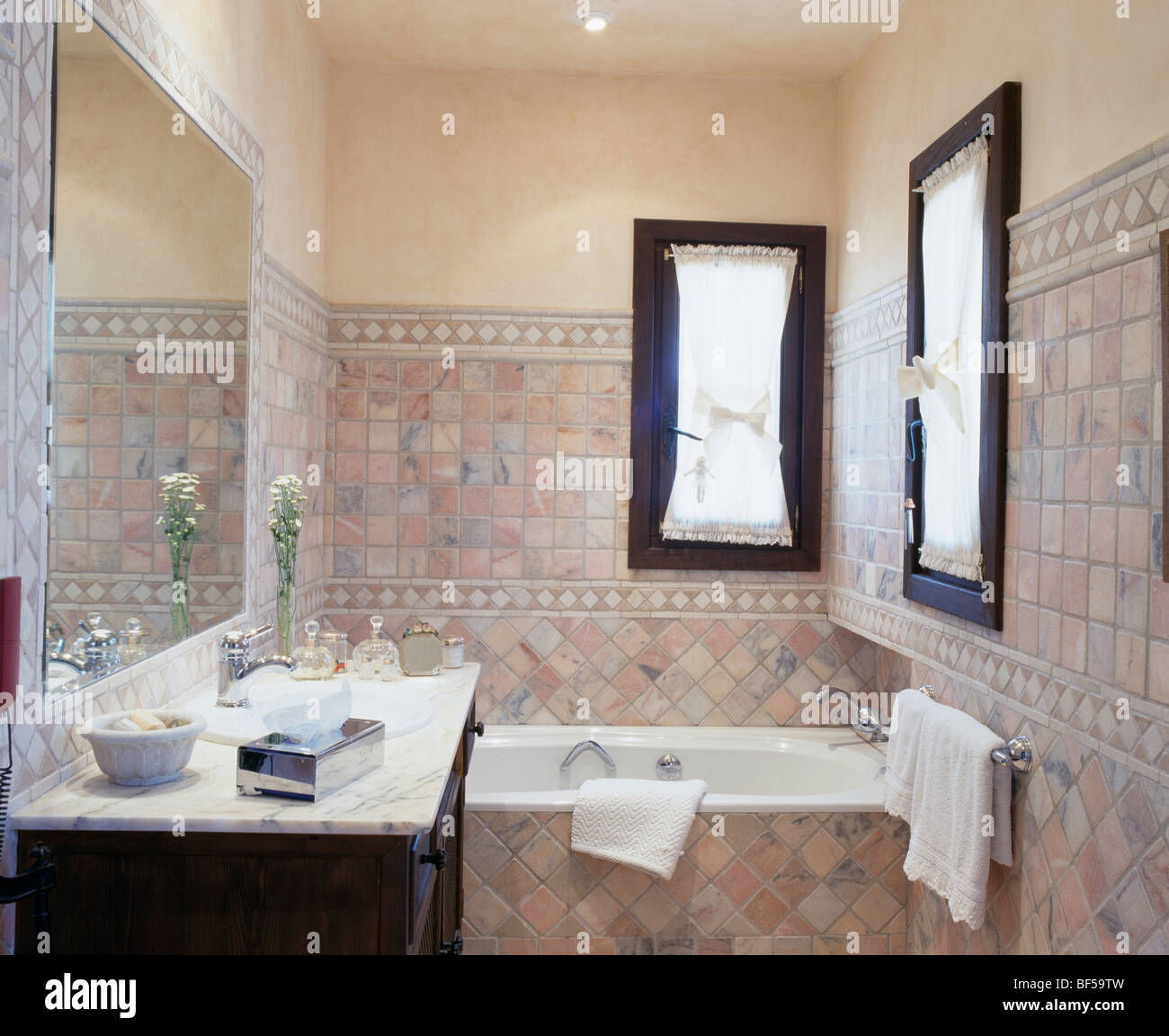 Small Spanish bathroom with tiled walls Stock Photo, Royalty Free ...