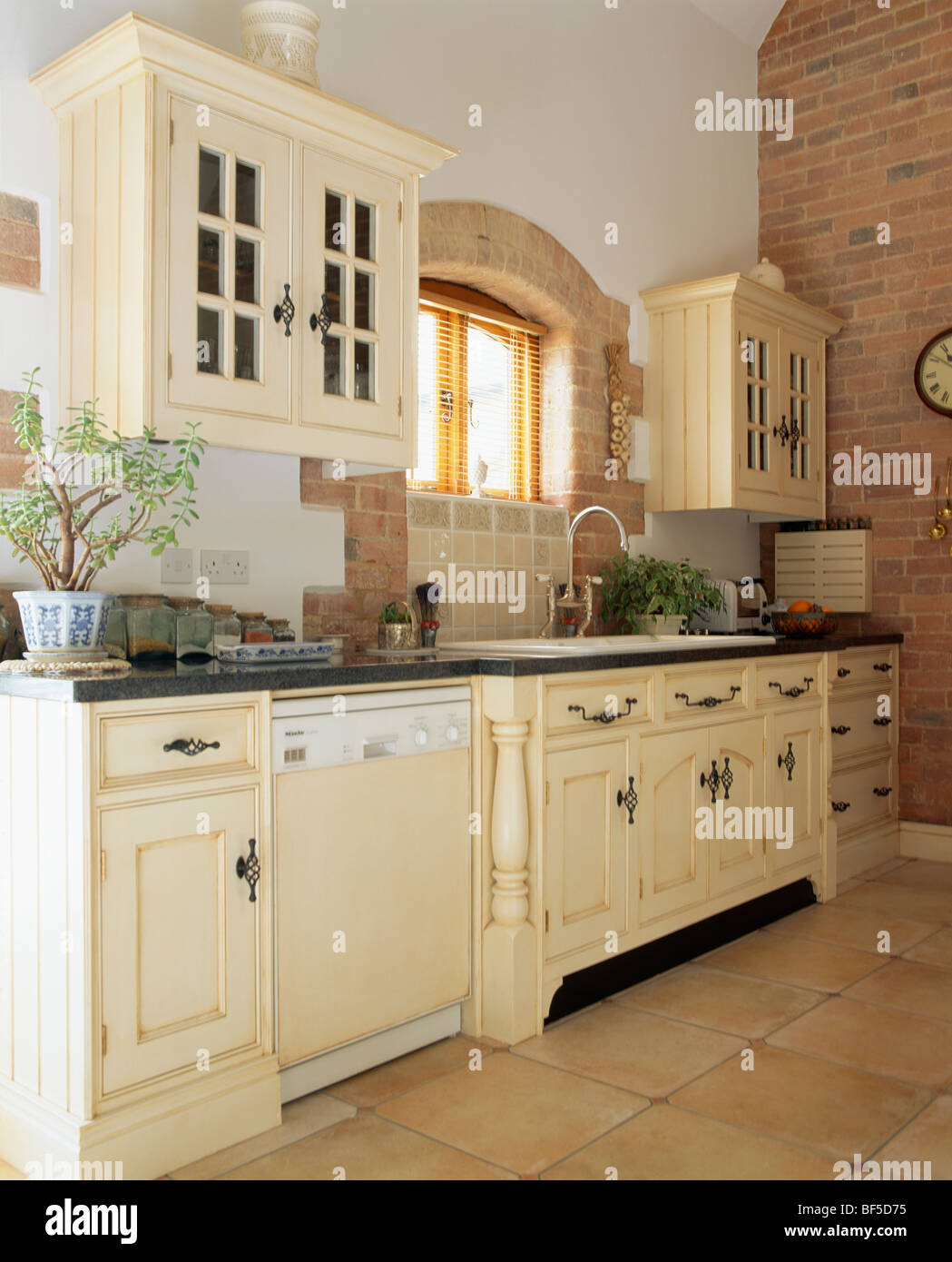 Stock Photo Traditional Cream Country Kitchen With Dishwasher In Fitted Unit