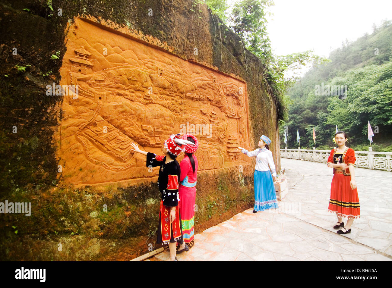 Tujia Woman In Traditional Costume Looking At Map Carved On The - Enshi map