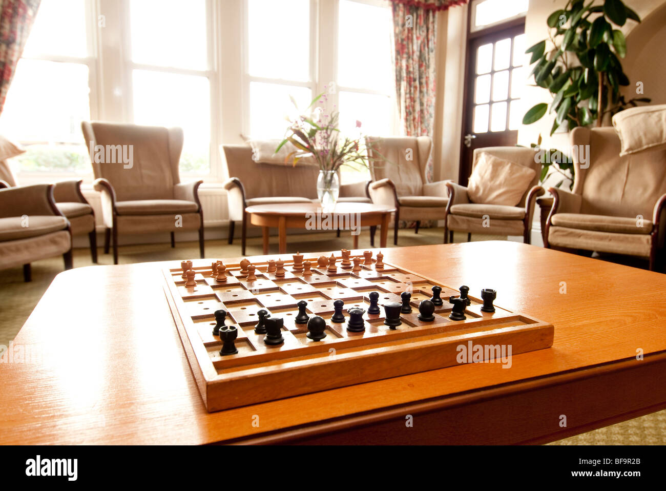 chess set on a table in living room & chess set on a table in living room Stock Photo: 26645875 - Alamy