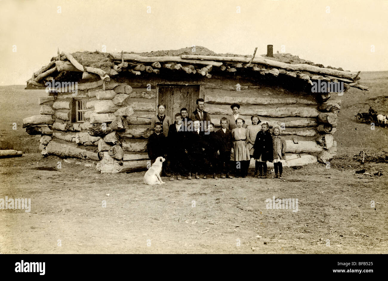 Dog Inspecting Students At One Room Log Cabin Schoolhouse