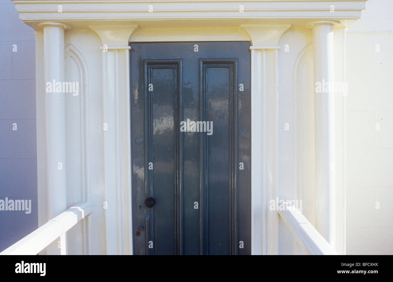 Stock Photo - Stylish wooden front door painted dark grey with white painted pillars moulded half-pillars portico and handrails & Stylish wooden front door painted dark grey with white painted ... Pezcame.Com