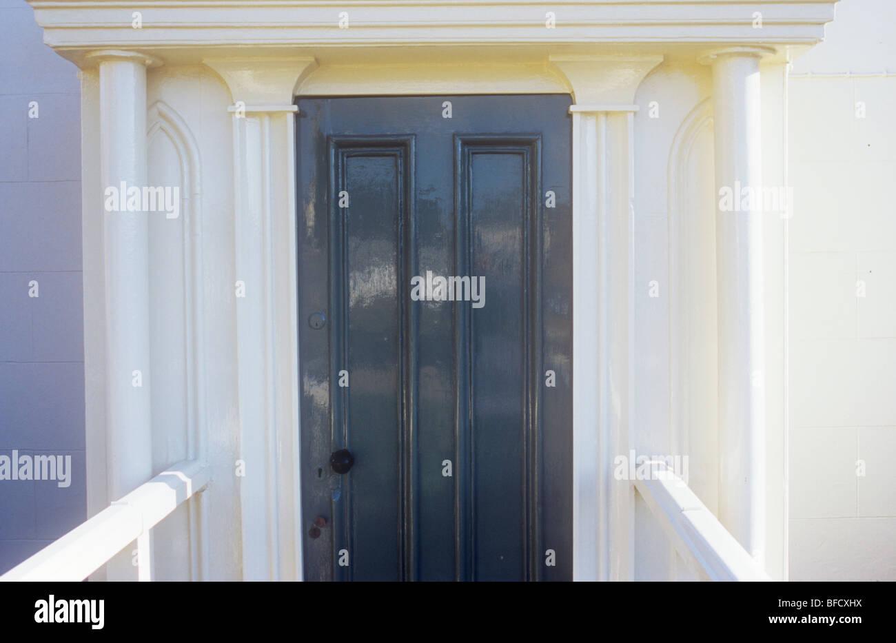 Stylish wooden front door painted dark grey with white painted stylish wooden front door painted dark grey with white painted pillars moulded half pillars portico and handrails rubansaba