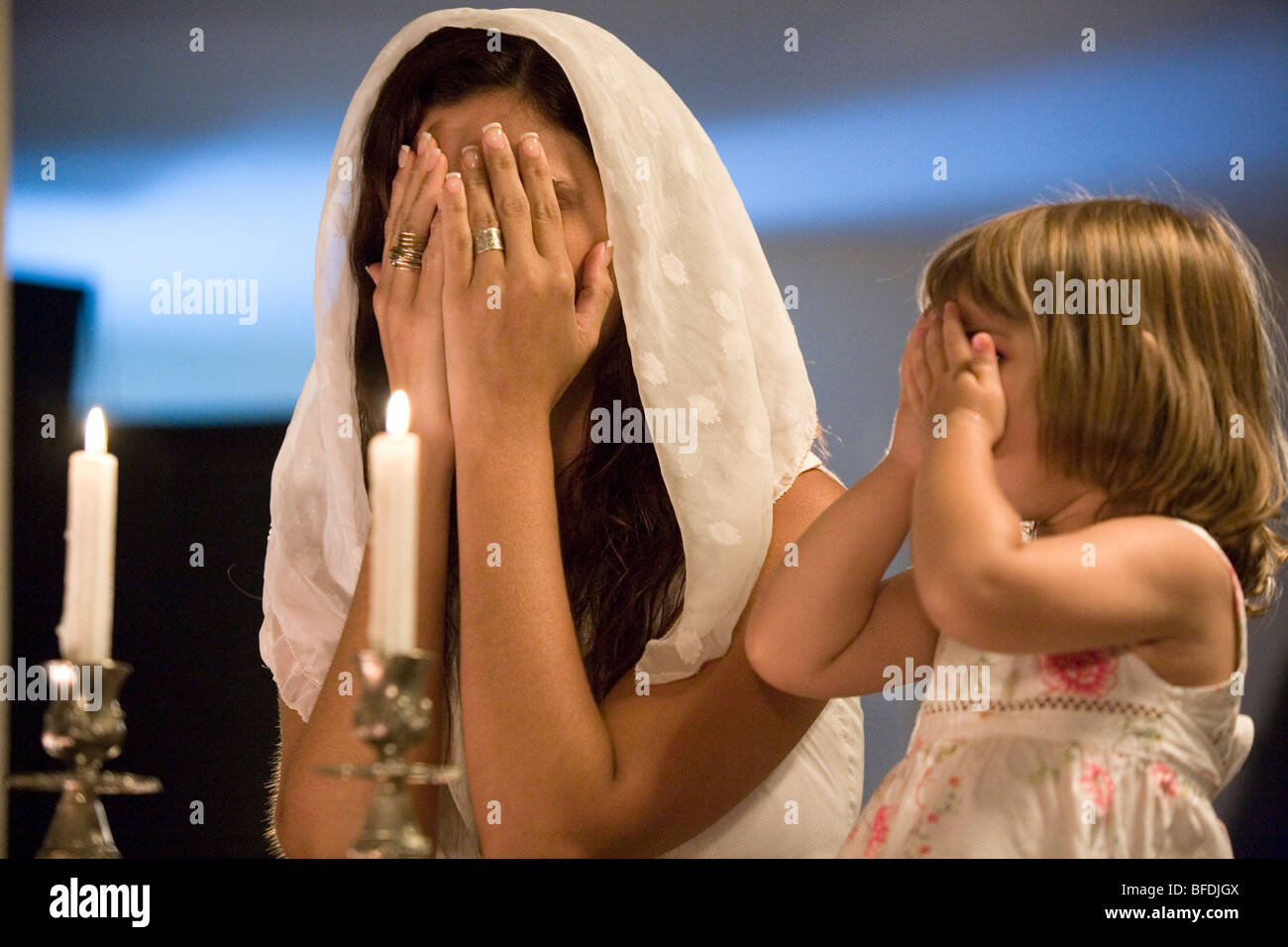 Mother and daughter blessing on Shabbat candles & Mother and daughter blessing on Shabbat candles Stock Photo ... azcodes.com