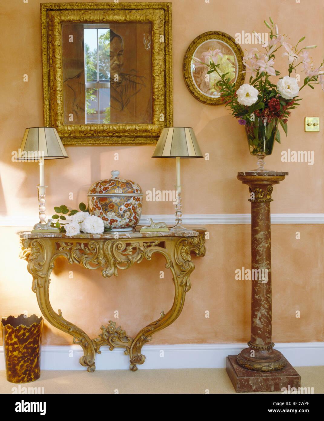 Gilt mirror above ornate baroque console table in traditional cream stock photo royalty free - Ornate hall table ...