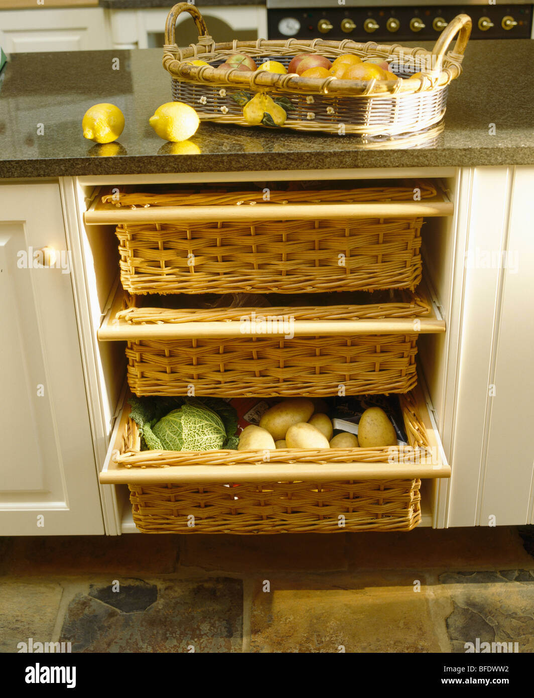 close up of kitchen storage baskets in cream fitted unit. Black Bedroom Furniture Sets. Home Design Ideas
