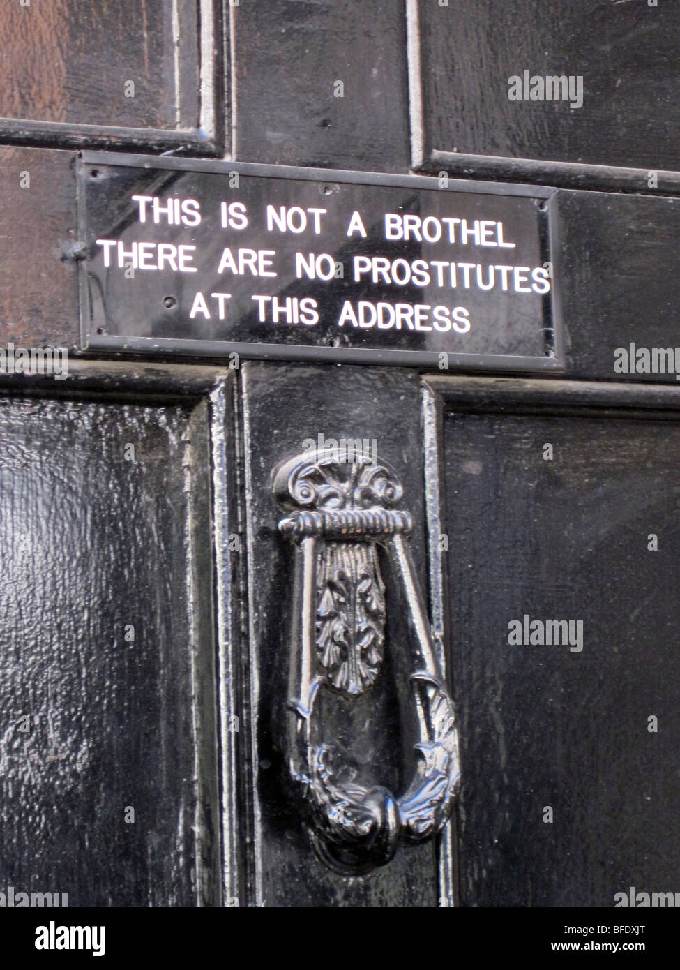 No prostitution, brothel and soliciting signs on doors in Soho, London, England