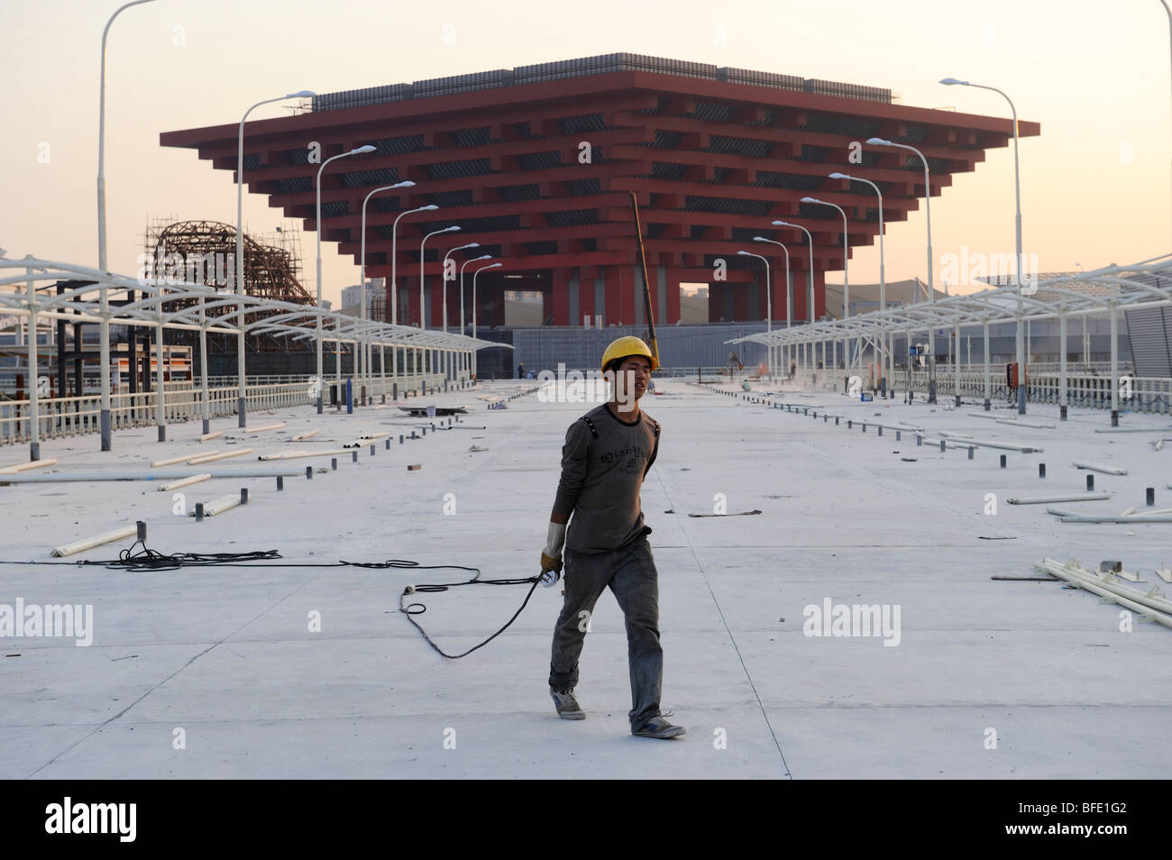 A worker in front of China Pavilion of the World Expo 2010 in ...