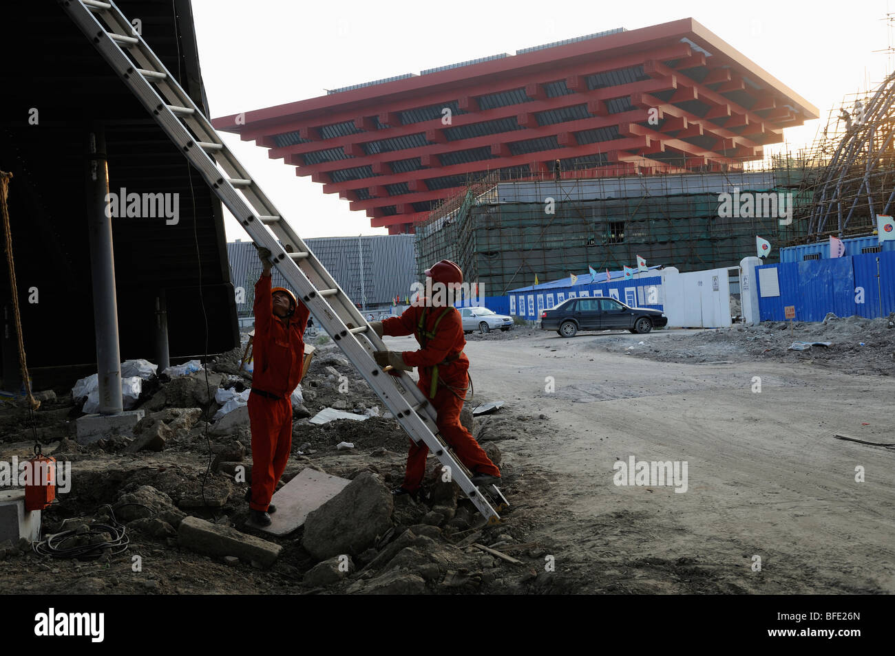 Workers in front of China Pavilion of the World Expo 2010 in ...