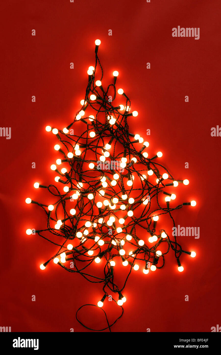 Christmas String Lights Background : christmas tree design made from string of lights on a red background Stock Photo, Royalty Free ...