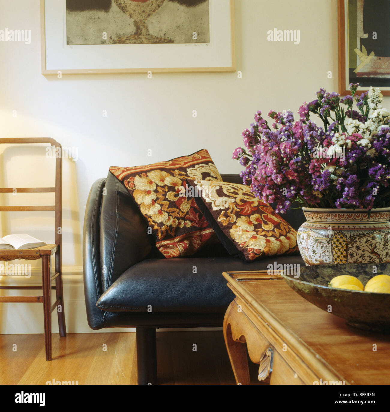 Dried Flower Arrangement On Table In Living Room With Tapestry Cushions On Leather  Sofa
