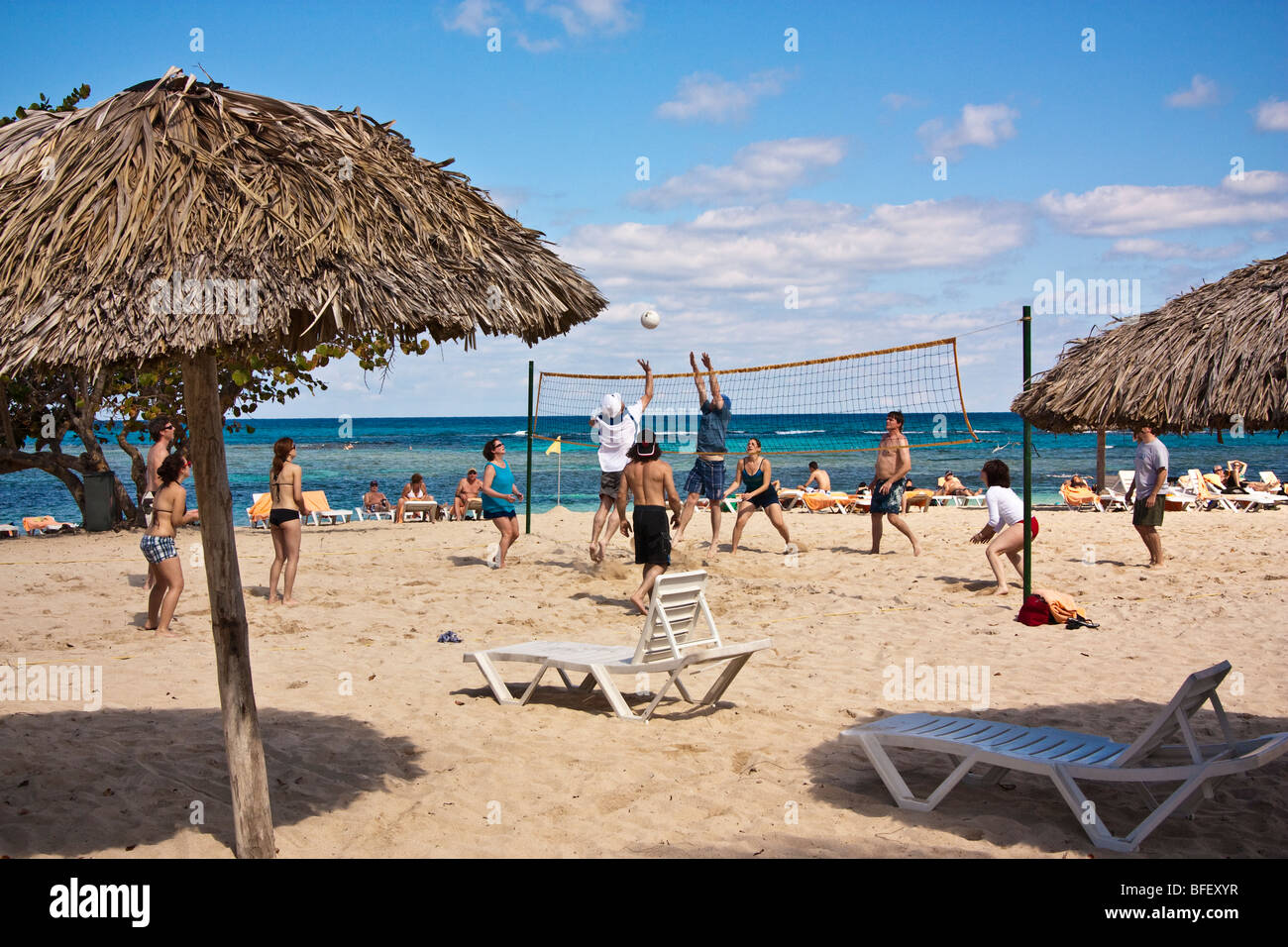 People Playing Beach Volleyball Caribbean Cuban Resort Stock