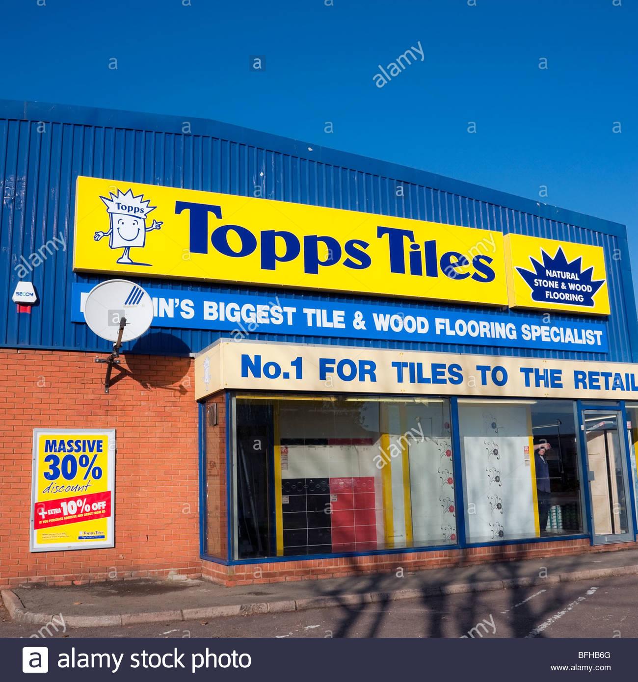 Topps tiles shop britains biggest tile wood flooring stock photo topps tiles shop britains biggest tile wood flooring specialist topps tiles retail unit uk dailygadgetfo Images