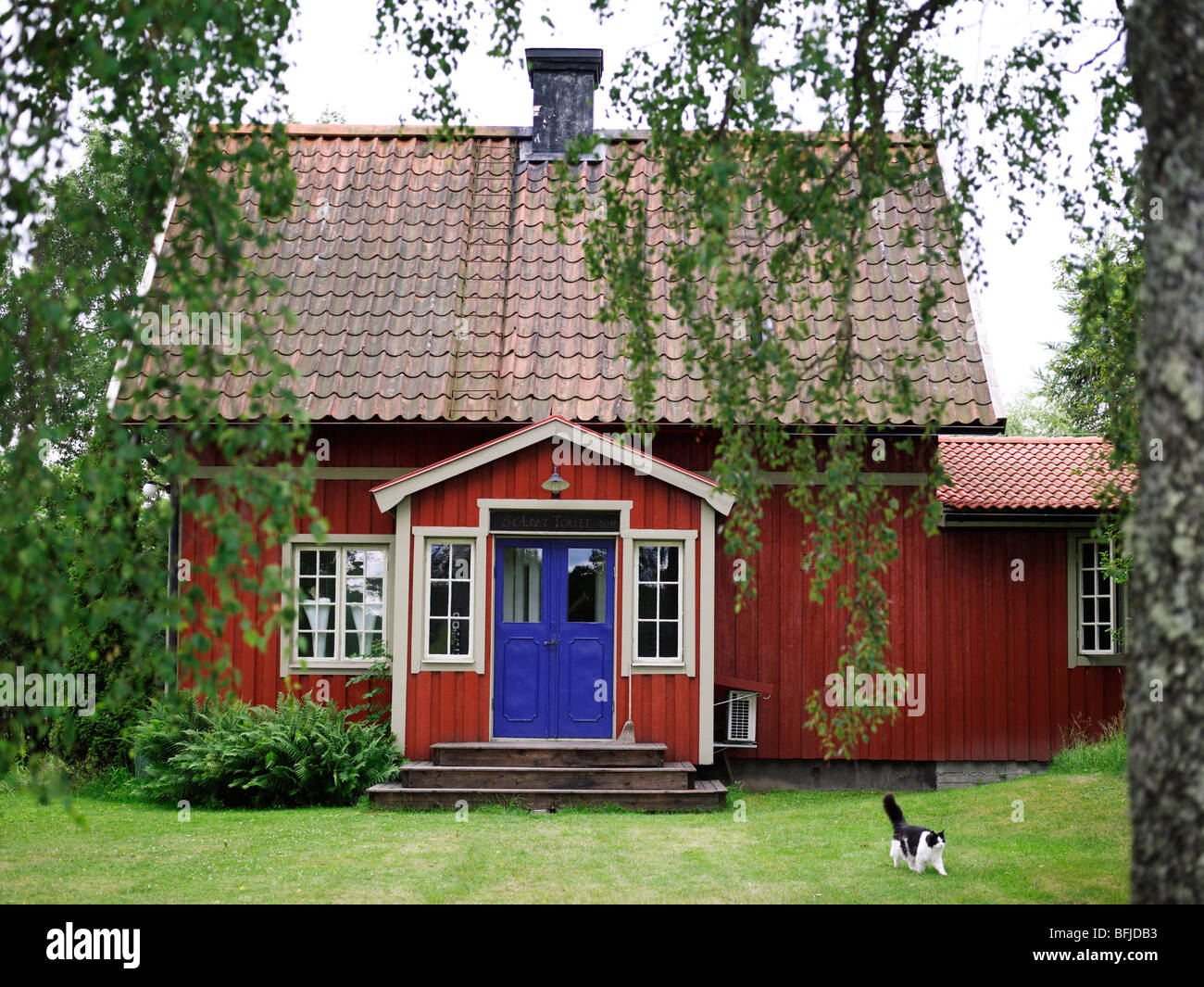 A Red House With A Blue Door Sweden Stock Image