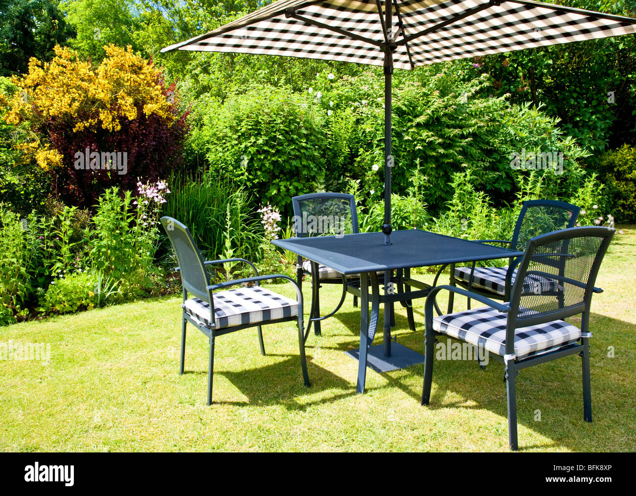 modern garden furniture set out on a lawn in a typical