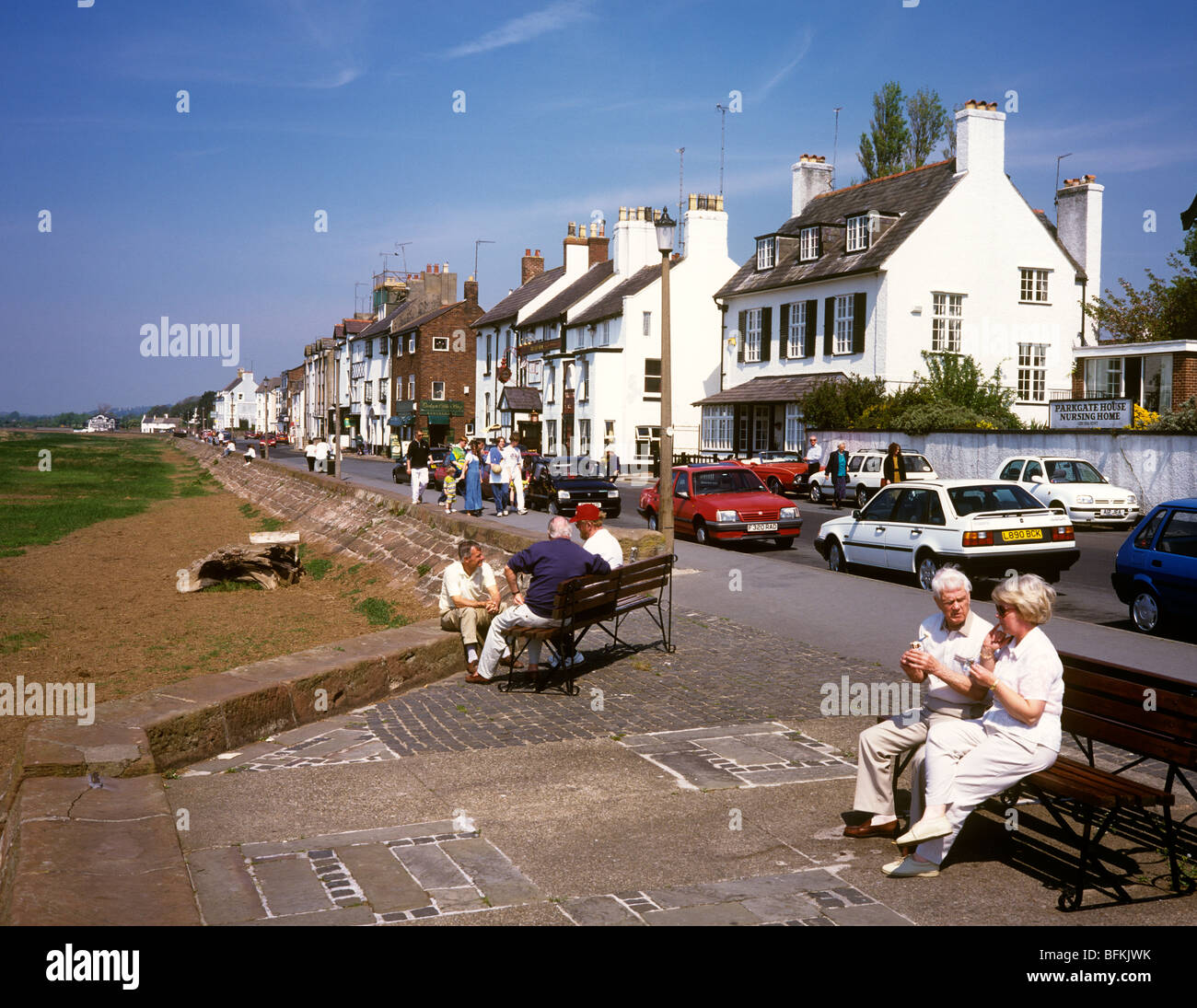 UK England Wirral Parkgate Promenade People Eating Ice Creams Sitting In Sunshine