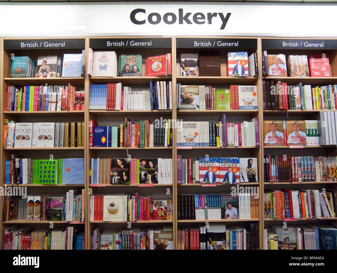 cookery books on shelves, Foyles bookshop, London, England, UK