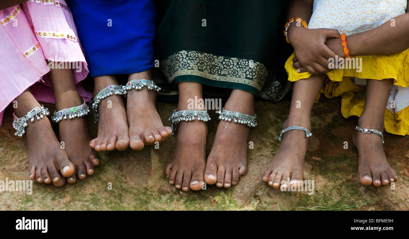 Four Indian Girls Legs, Arms And Feet With Ankle Bracelets And Glass  Bangles Sitting On