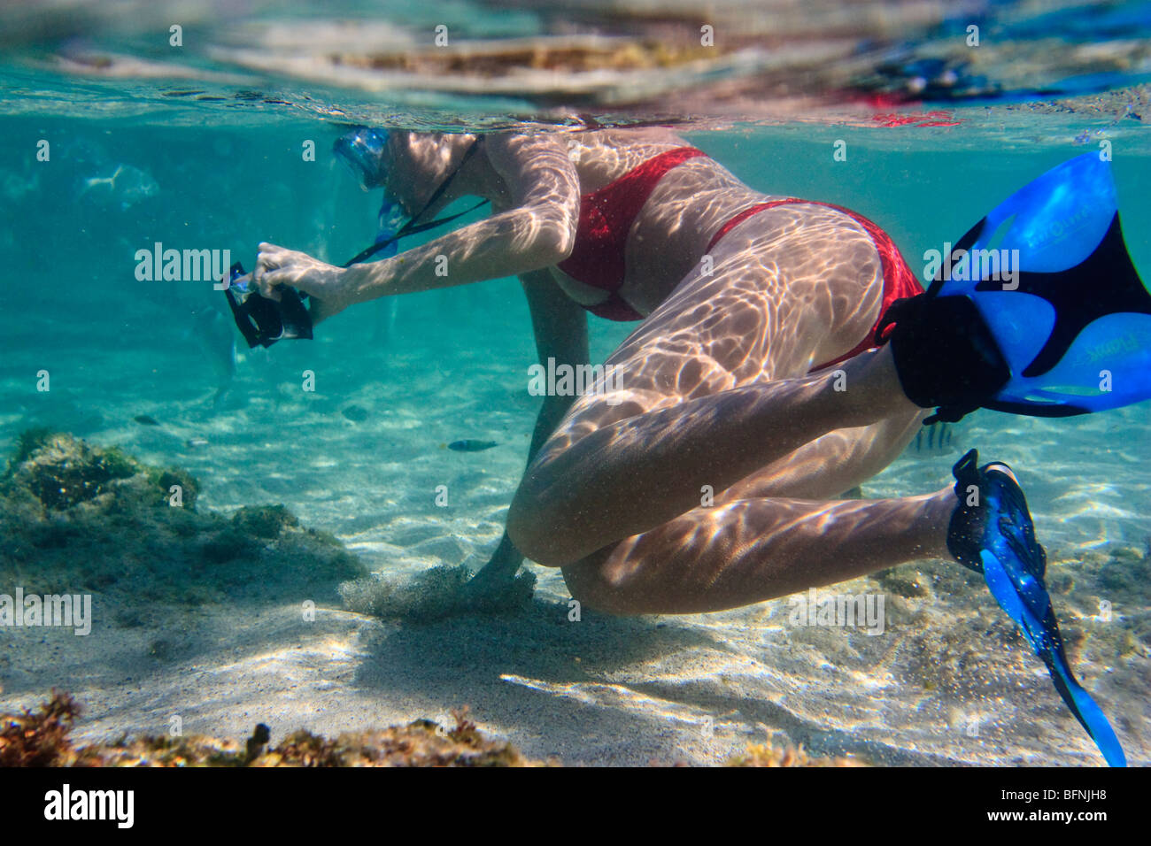 Perfect Snorkeling Young Woman Holds Onto The Sandy Ocean Floor As She Tries To  Steady Herself And