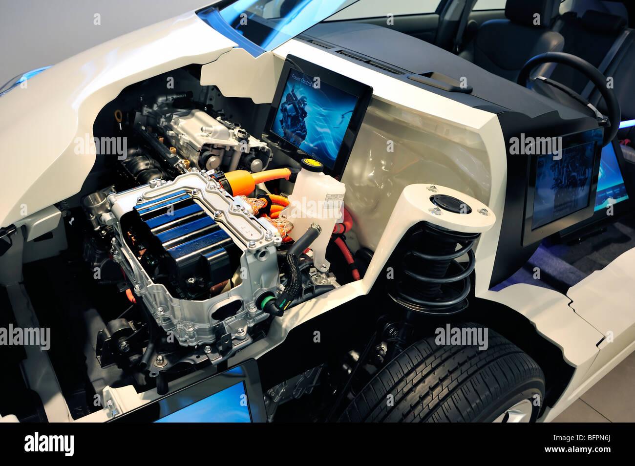 Paris france new car showroom toyota car detail gas for Hybrid car electric motor