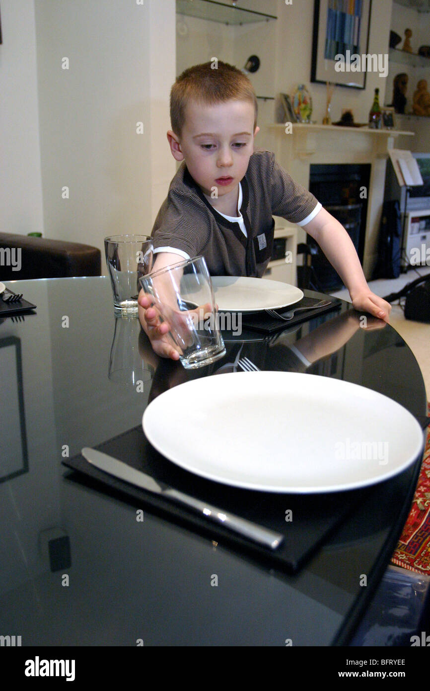 young boy helping to set table  sc 1 st  Alamy & young boy helping to set table Stock Photo: 26956678 - Alamy