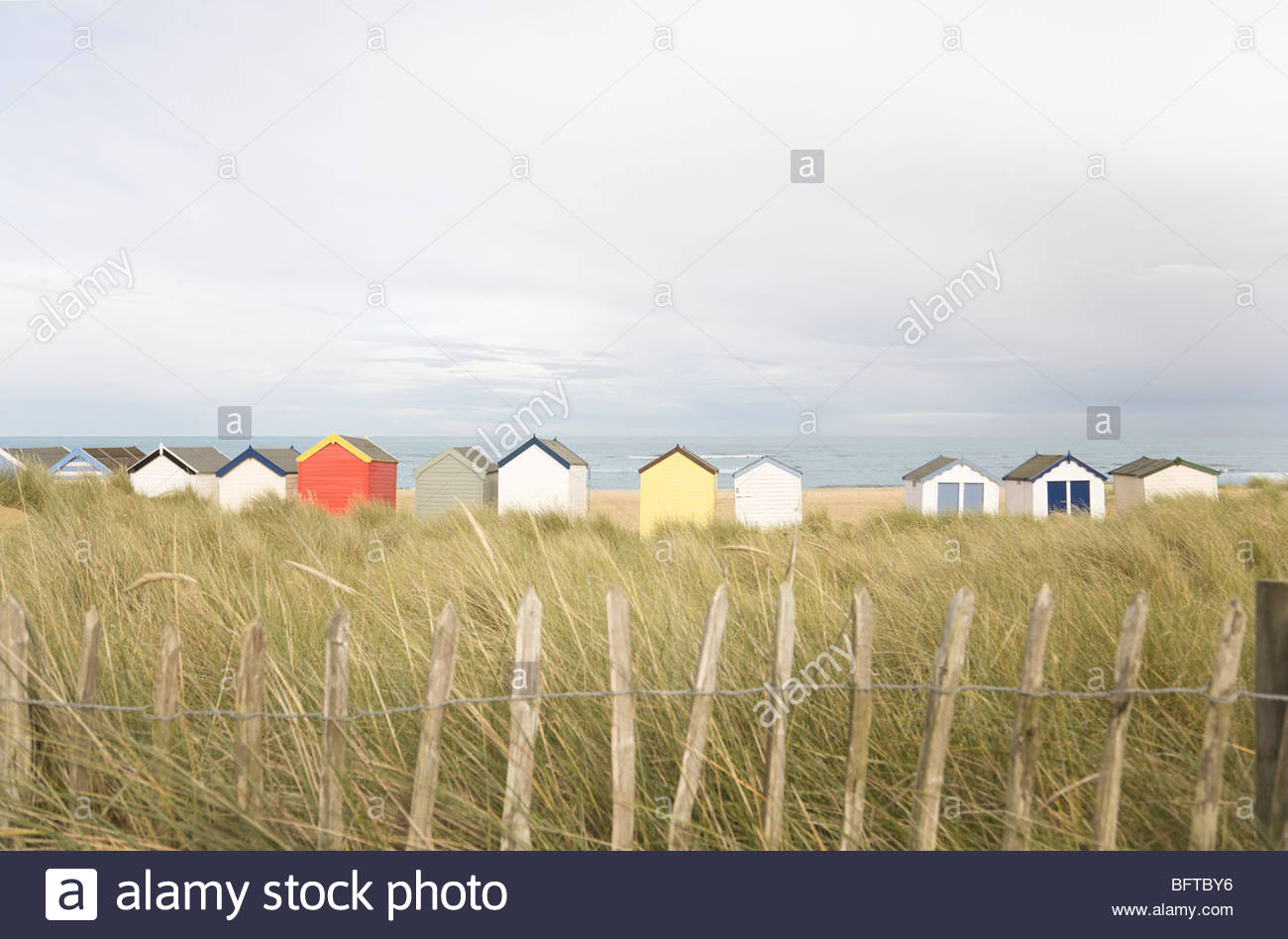 Beach Huts Behind Fencing Stock Photo Royalty Free Image
