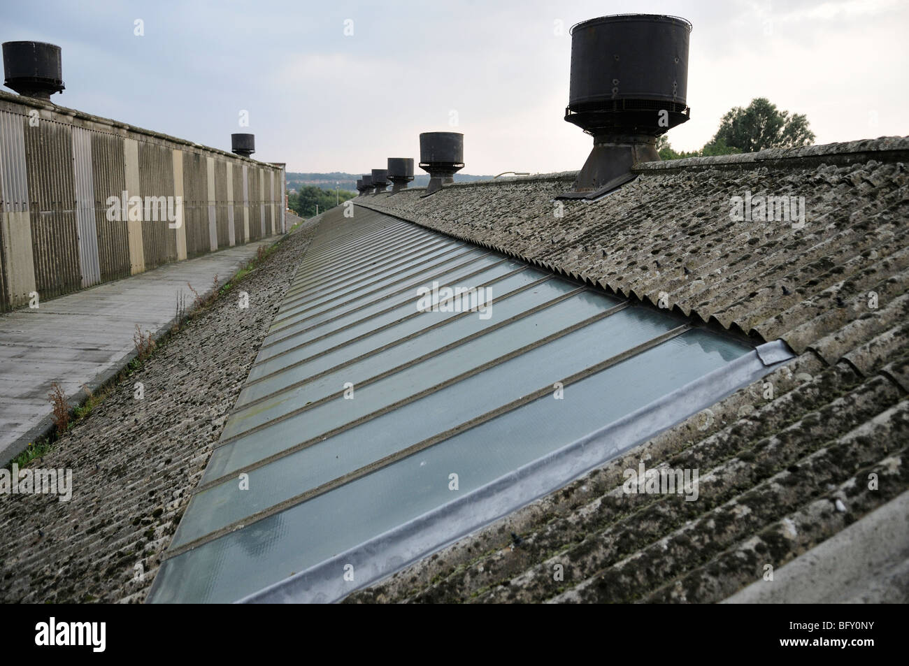 Long Factory Roof Made Of Asbestos Cement Sheeting Showing Roof Vents And  Glass Panels