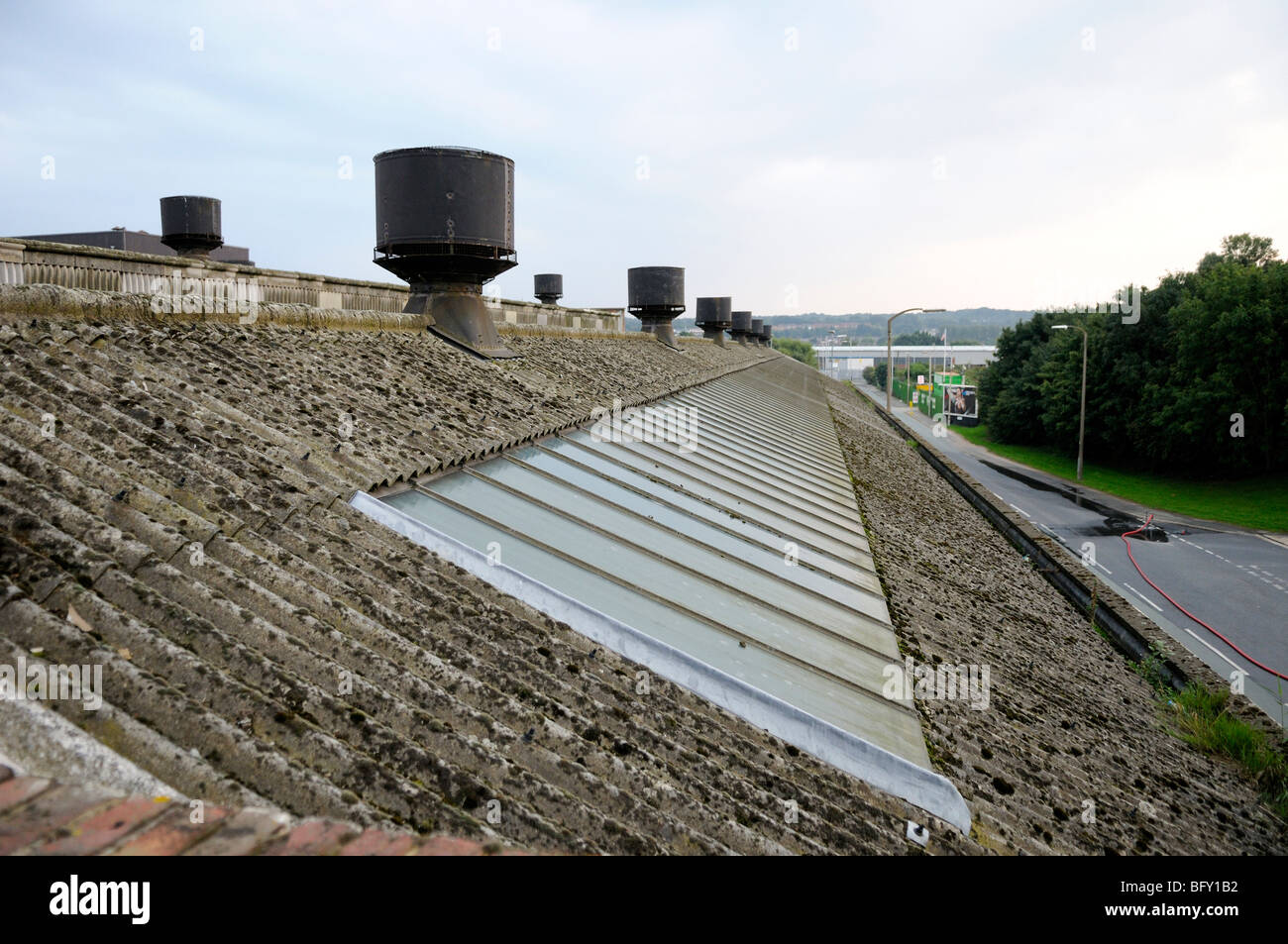 Long Factory Roof Made Of Asbestos Cement Sheeting Showing