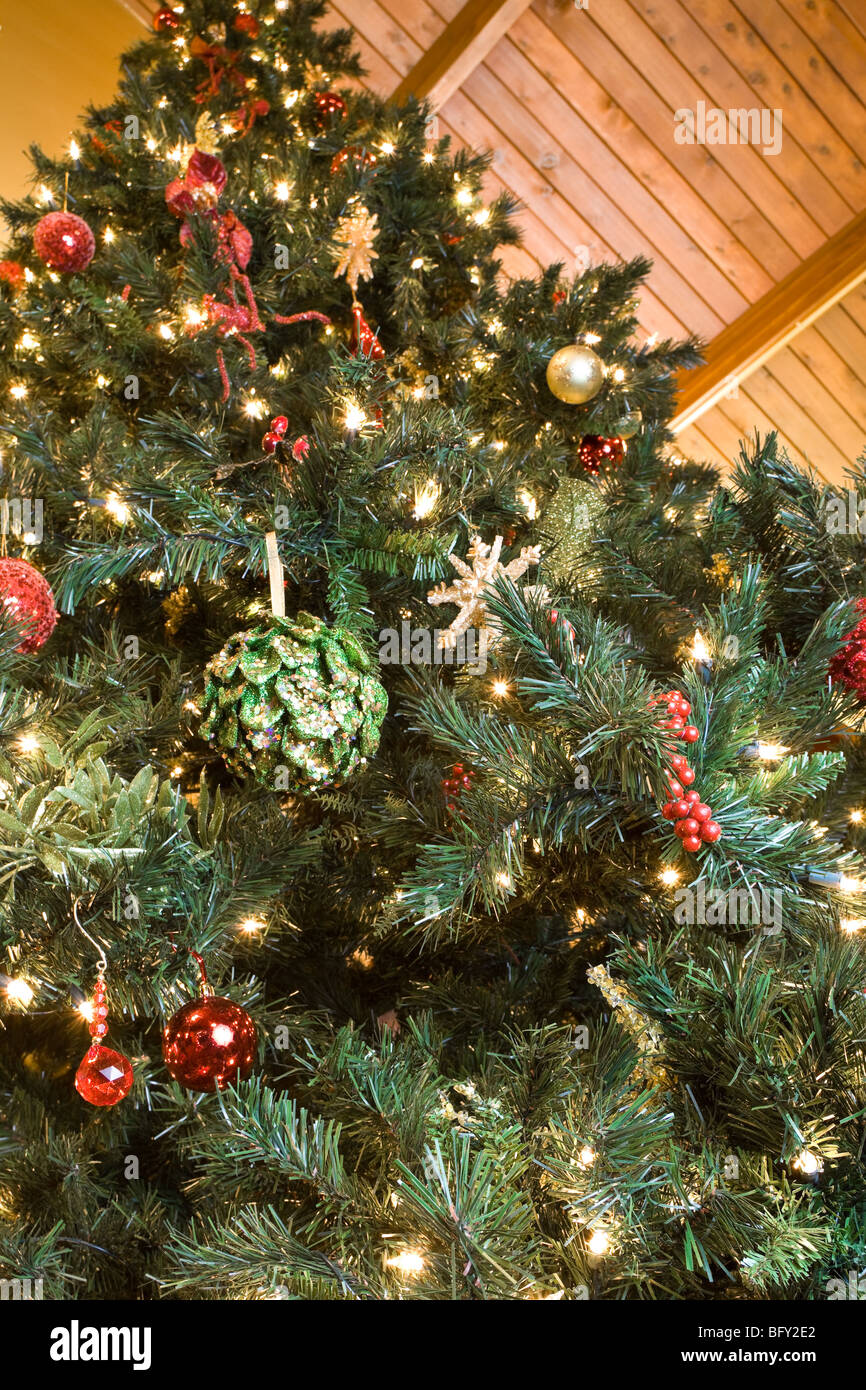 Large ornaments - Looking Up At A Large Indoor Christmas Tree Full Of Ornaments And Twinkly Lights