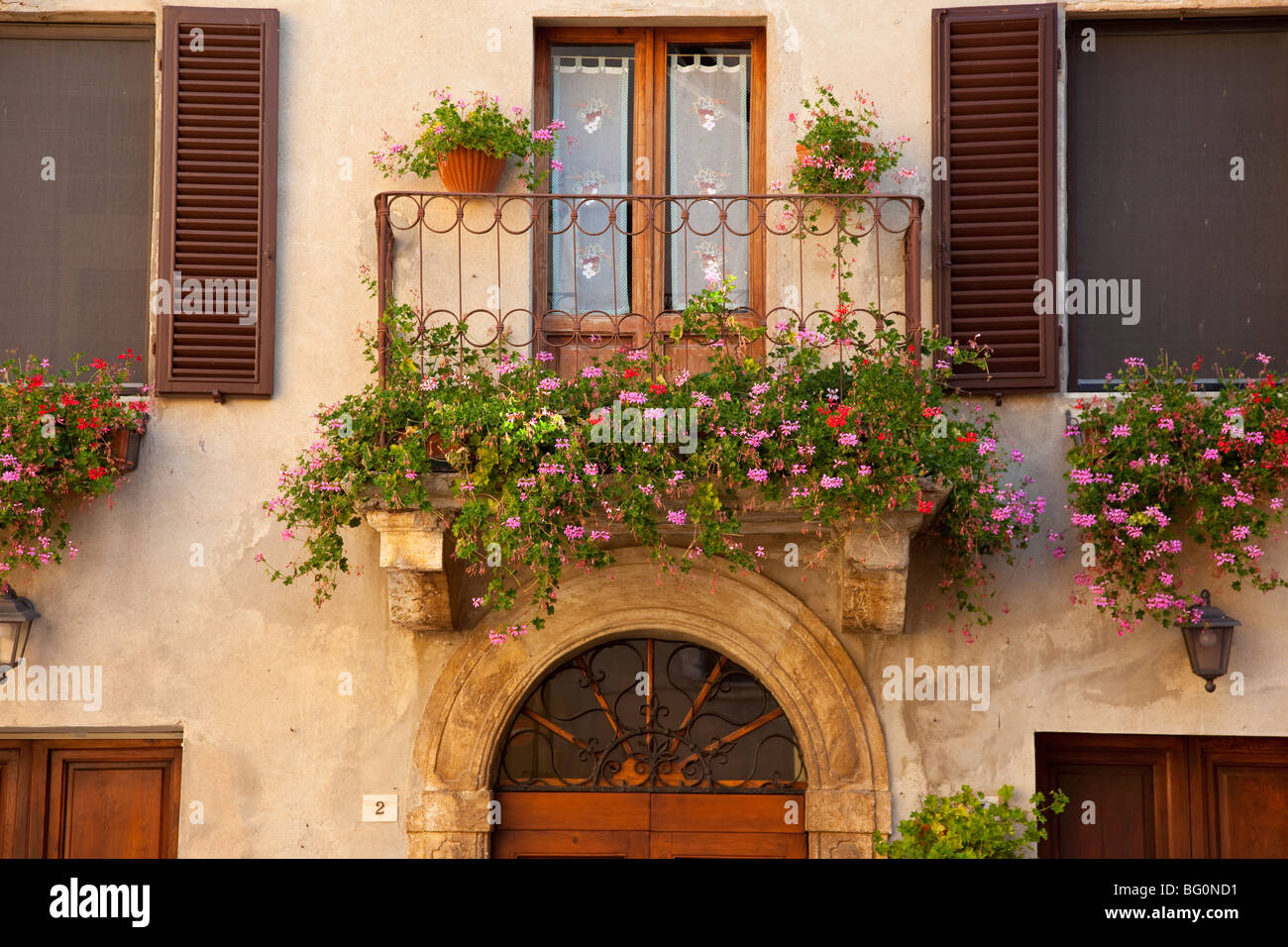 Balcony of flowers a beautiful home in Piezna Tuscany Italy Stock Ro