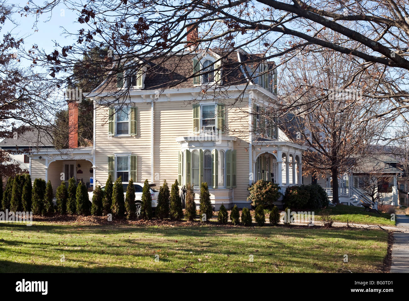 Elegant Pale Yellow Victorian House Exterior With Moss Green Shutters Hip Roof Dormer Windows In Montgomery New York